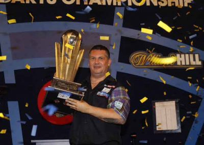 Gary Anderson lifting the trophy at the championship