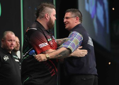Gary Anderson and Mike Smith smiling at a darts match