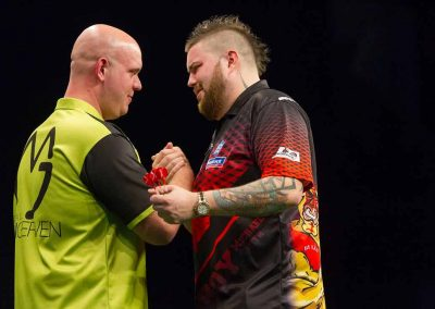 Mike Smith and an opponent during a darts match