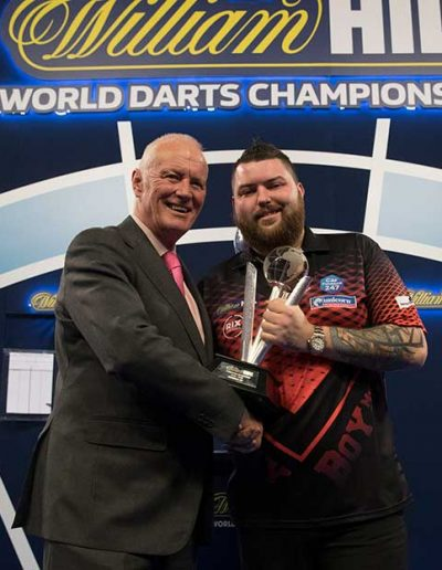 Mike Smith being awarded a trophy at the world darts championship