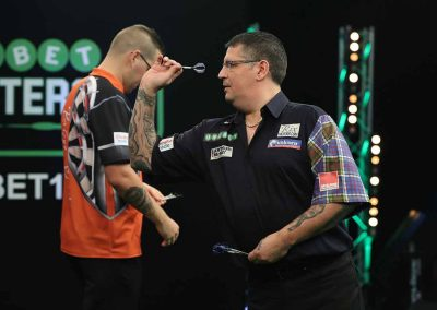 Gary Anderson throwing a dart during a match