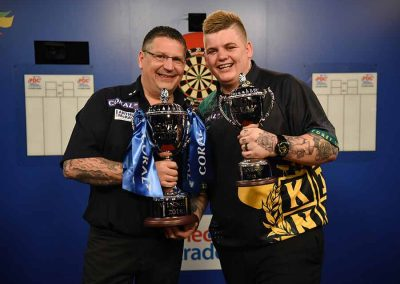 Gary Anderson with a colleague holding trophies during the uk open