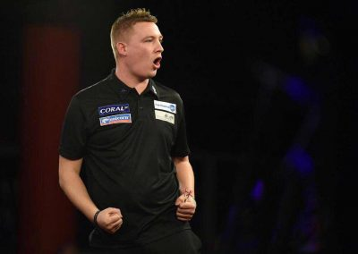 Chris Dobey during a darts match