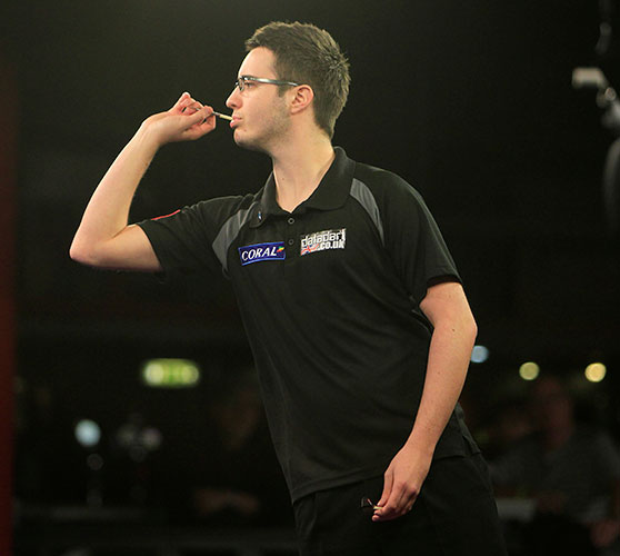Adam Hunt throwing darts during a match