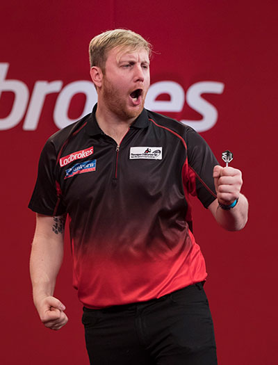 Cameron Menzies during a darts match